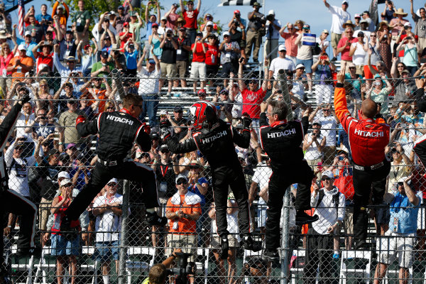 1 June, 2014, Detroit, Michigan, USA Winner Helio Castroneves climbs the fence ©2014, Michael L. Levitt LAT Photo USA