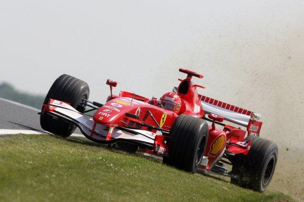 2006 British Grand Prix - Friday Practice Silverstone, England. 8th - 11th June. Michael Schumacher, Ferrari 248F1, action. World Copyirhgt: Jakob Ebrey/LAT Photographic ref: Digital Image JEB23505