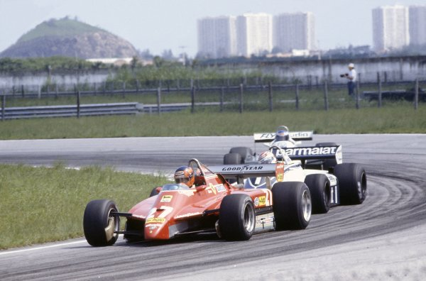 1982 Brazilian Grand Prix.Rio de Janeiro, Brazil. 19-21 March 1982.Gilles Villeneuve (Ferrari 126C2) leads Nelson Piquet (Brabham BT49D-Ford Cosworth) and Keke Rosberg (Williams FW07C-Ford Cosworth).World Copyright: LAT PhotographicRef: 35mm transparency 82BRA15