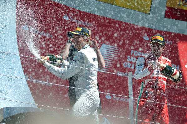 Silverstone, Northamptonshire, England 30th June 2013 Nico Rosberg, Mercedes AMG, 1st position, Mark Webber, Red Bull Racing, 2nd position, and Fernando Alonso, Ferrari, 3rd position, celebrate on the podium World Copyright: Chris Bird/  ref: Digital Image _CJB6798