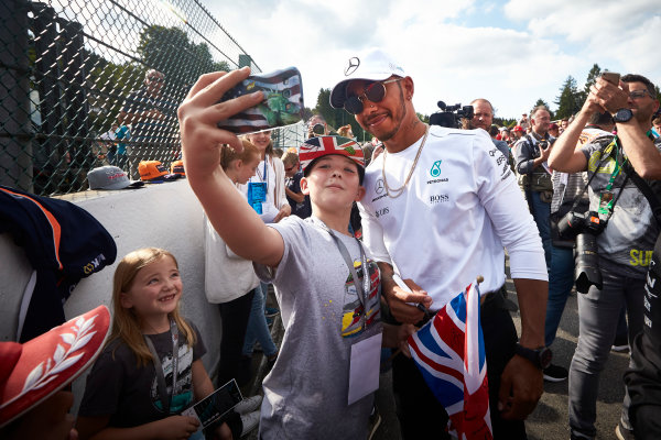 Spa Francorchamps, Belgium.  Thursday 24 August 2017. Lewis Hamilton, Mercedes AMG, takes a photo with a fan. World Copyright: Steve Etherington/LAT Images  ref: Digital Image SNE17458