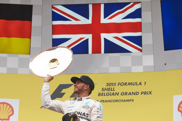 Spa-Francorchamps, Spa, Belgium. Sunday 23 August 2015. Lewis Hamilton, Mercedes F1 W06 Hybrid sprays the champagne on the podium after winning the race. World Copyright: Steve Etherington/LAT Photographic ref: Digital Image SNE22722