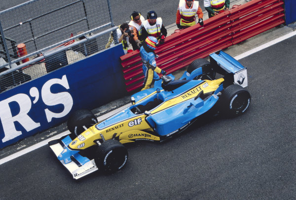 2003 British Grand PrixSilverstone, England. 18th - 20th July 2003.Fernando Alonso, Renault R23, retires from the race.World Copyright: Steven Tee / LAT Photographic ref: 35mm Image 03GB35