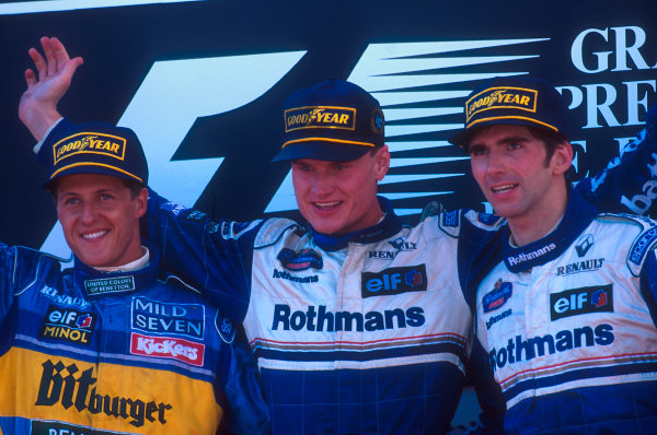 Estoril, Portugal.22-24 September 1995.David Coulthard (Williams Renault) 1st position, his maiden Grand Prix win. Michael Schumacher (Benetton Renault) 2nd position and Damon Hill (Williams Renault) 3rd position on the podium.Ref-95 POR 01.World Copyright - LAT Photographic