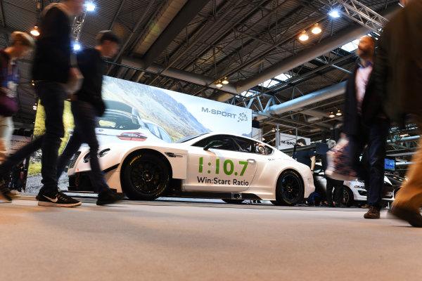 Autosport International Exhibition. National Exhibition Centre, Birmingham, UK. Friday 13 January 2017. Fans walk past an M-Sport Bentley. World Copyright: Sam Bagnall/LAT Photographic. Ref: DSC_2979