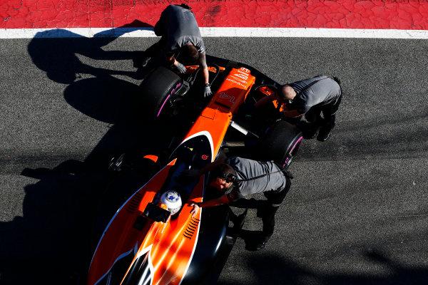 Circuit de Barcelona Catalunya, Barcelona, Spain. Friday 10 March 2017. Mechanics push the Fernando Alonso McLaren MCL32 Honda from the pit lane into his garage. World Copyright: Zak Mauger/LAT Images ref: Digital Image _L0U6088