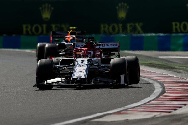 Kimi Raikkonen, Alfa Romeo Racing C38, leads Pierre Gasly, Red Bull Racing RB15