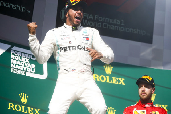 Race Winner Lewis Hamilton, Mercedes AMG F1 celebrates on the podium with Sebastian Vettel, Ferrari