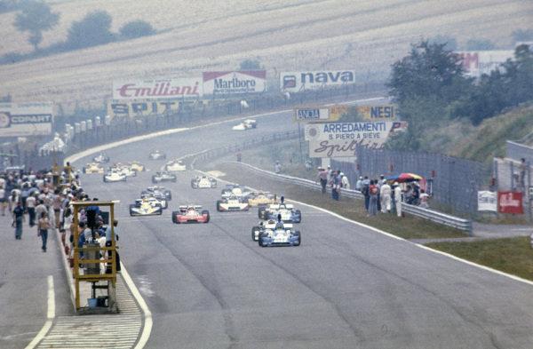 Patrick Tambay, Martini Mk19 Renault/Gordini, leads the field at the start.