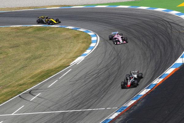 Romain Grosjean, Haas F1 Team VF-18 Ferrari, leads Sergio Perez, Force India VJM11 Mercedes, and Carlos Sainz Jr., Renault Sport F1 Team R.S. 18.