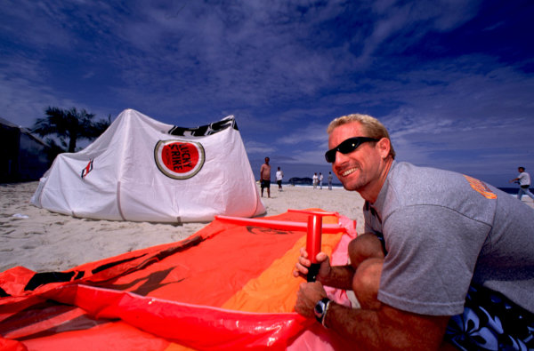 2000 Brazilian Grand Prix.Interlagos, Sao Paulo, Brazil.23-26 March 2000.Windsurfing World champion Robby Naish prepares his board at the Lucky Strike beach party.World Copyright - Tee/LAT Photographic