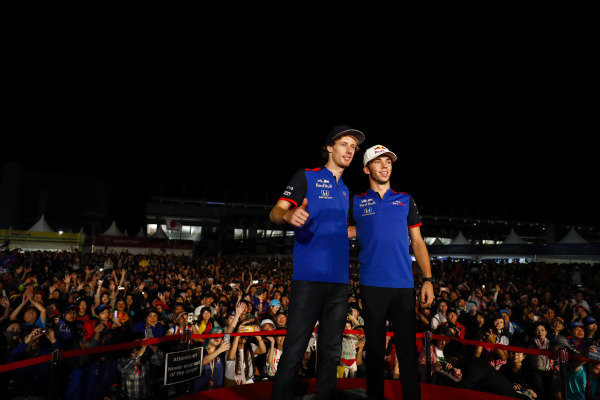 Pierre Gasly, Toro Rosso, and Brendon Hartley, Toro Rosso, attend a fan event.