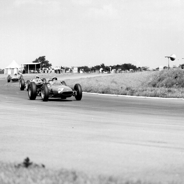 1963 British Grand Prix.Silverstone, England.18-20 July 1963.Lorenzo Bandini (BRM P57) leads Masten Gregory ((Lotus 24 BRM). They finished in 5th and 11th positions respectively.Ref-20405.World Copyright - LAT Photographic
