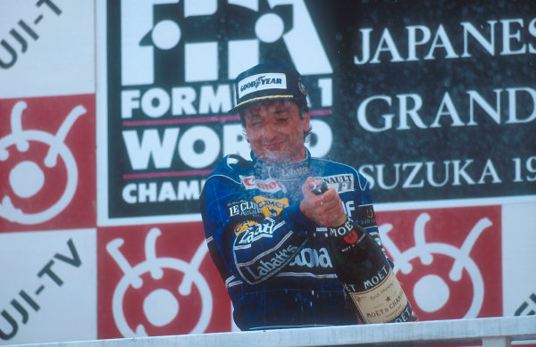 1992 Japanese Grand Prix.Suzuka, Japan.23-25 October 1992.Riccardo Patrese (Williams FW14B Renault) 1st position, sprays the champagne on the podium. This was his last Grand Prix win.Ref-92 JAP 03.World Copyright - LAT Photographic