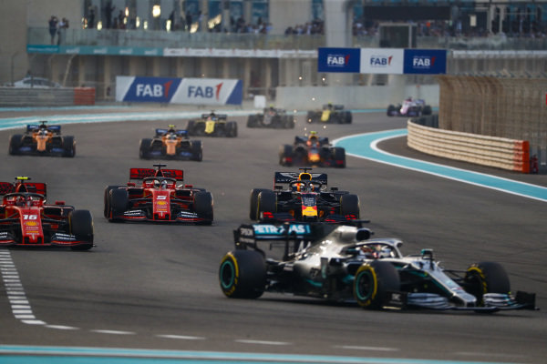 Lewis Hamilton, Mercedes AMG F1 W10, leads Charles Leclerc, Ferrari SF90, Sebastian Vettel, Ferrari SF90, Max Verstappen, Red Bull Racing RB15, and the rest of the field on the opening lap
