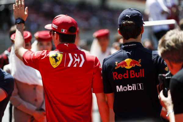 Charles Leclerc, Ferrari, and Pierre Gasly, Red Bull Racing, at the drivers parade