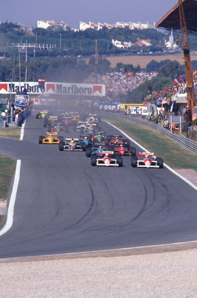 1988 Portuguese Grand Prix.Estoril, Portugal.23-25 September 1988.Alain Prost on the inside of teammate Ayrton Senna (both McLaren MP4/4 Honda's) with Ivan Capelli (March 881 Judd) and Gerhard Berger (Ferrari F187/88C) behind at the start.Ref-88 POR 06.World Copyright - LAT Photographic