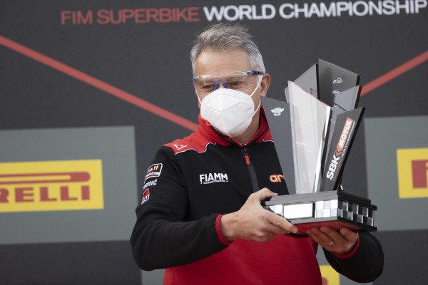 Serafino Foti celebrates with the team trophy.
