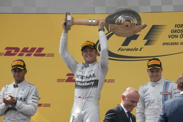 Nico Rosberg celebrates victory on the podium.