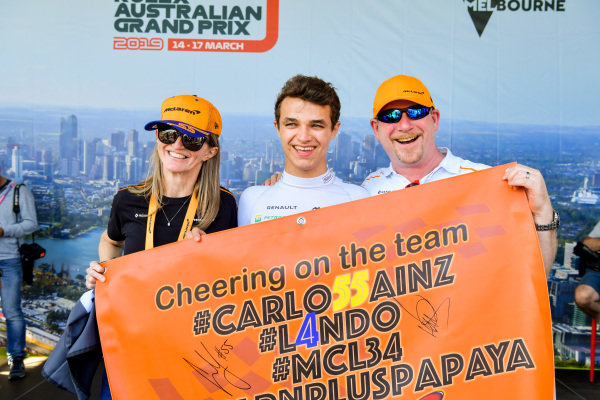 Lando Norris, McLaren, poses with fans
